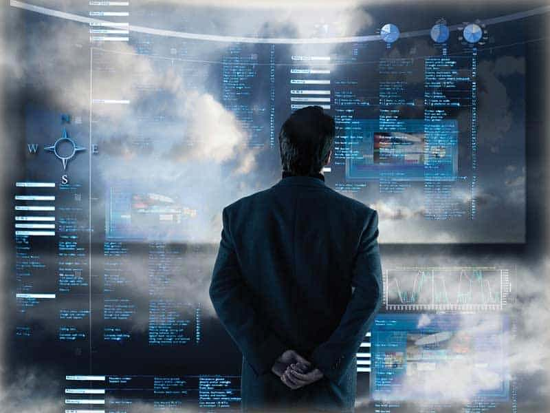 Man Observing Dashboards On Screens Looking for Ad Fraud